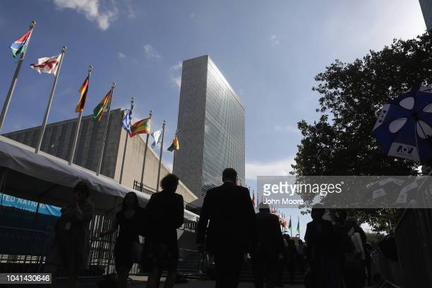 People walk past the United Nations headquarters on September 26 2018 in New York City World leaders gathered for the 73rd annual meeting at the UN...