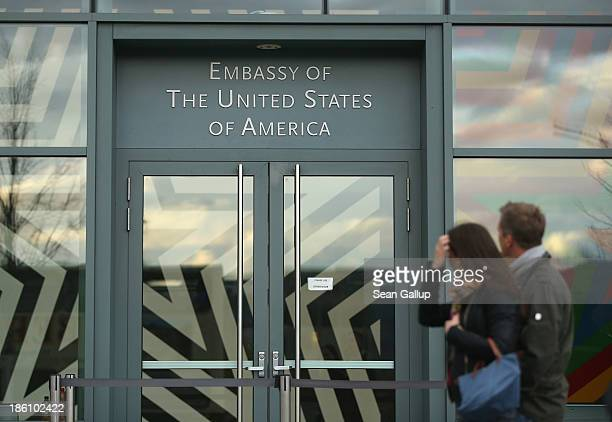 People walk past the U.S. Embassy on October 28, 2013 in Berlin, Germany. The embassy is becoming a focus in the current scandal over eavesdropping...