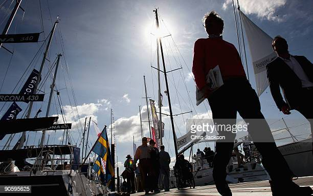 People walk past yachts on the first day of the PSP Southampton Boat Show in Mayflower Park on September 11 2009 in Southampton England The tenday...