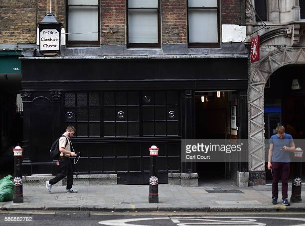 People walk past Ye Olde Cheshire Cheese pub formerly a famous haunt for journalists in Fleet Street on August 5 2016 in London England The last two...