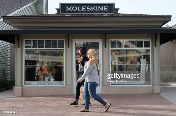 People walk the Moleskine store at the Woodbury Common Premium Outlets Mall on October 21 2017 in Central Valley NY