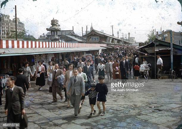 People walk the Nakamise Dori street main approach of Sensoji Temple on April 29 1952 in Tokyo Japan Japan restored the fully independence a day...
