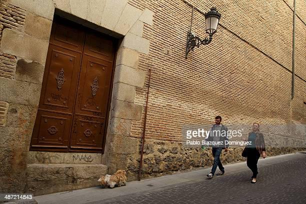 People walk their dog next to the Convento de las Trinitarias Descalzas on April 28 2014 in Madrid Spain The author of 'Don Quijote de la Mancha'...