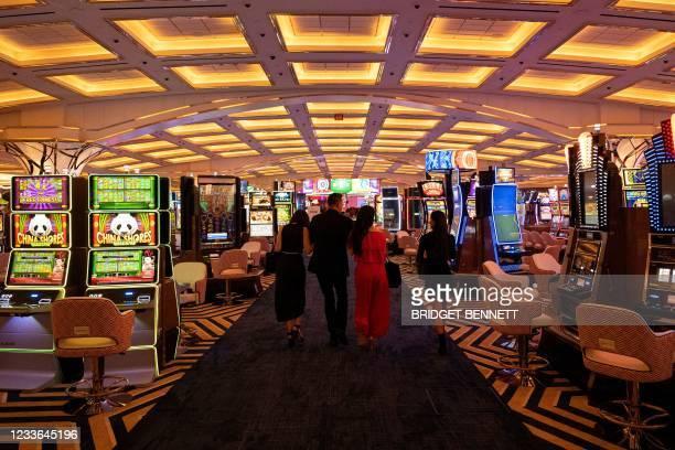 People walk thorough the casino floor during the celebratory grand opening of Resorts World Las Vegas hotel and casino on June 24, 2021 in Las Vegas,...