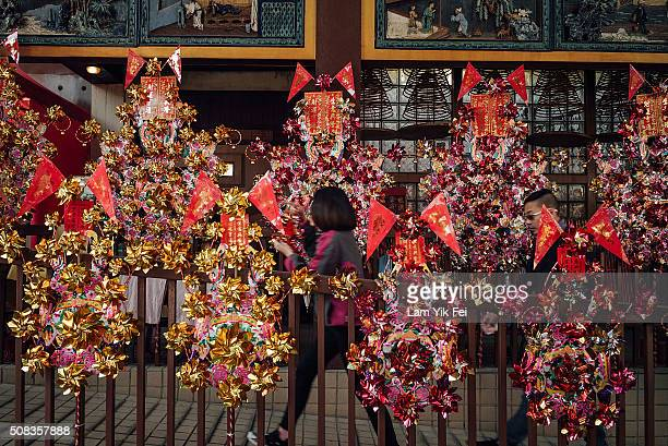 People walk through a aisle of pinwheel as a symbole to get rid of bad luck on February 4 2016 in Hong Kong Hong Kong The Chinese Lunar New Year also...