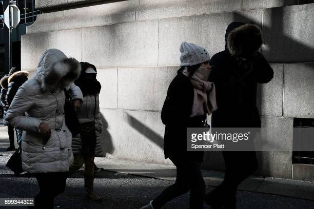 People walk through a frigid Manhattan on December 28 2017 in New York City Dangerously low temperatures and wind chills the central and eastern...