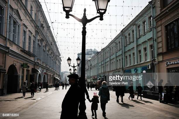People walk through a main avenue in Moscow on March 7 2017 in Moscow Russia Relations between the United States and Russia are at their lowest point...