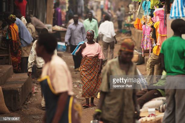 People walk through a market in the southern Sudanese city of Juba January 7 2011 in Juba Sudan South Sudan one of the world's poorest countries is...