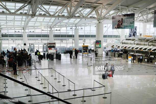 People walk through a nearly empty terminal at John F. Kennedy Airport on January 31, 2020 in New York City. As fears grow around the globe over the...