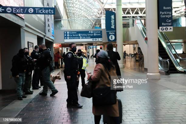 People walk through a nearly empty Union Station in Washington the day after the inauguration of Joseph Biden as president on January 21, 2021 in...