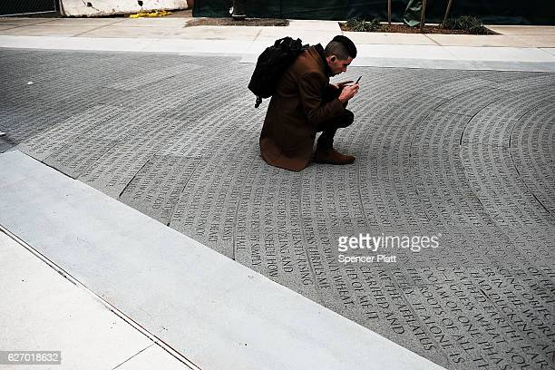 People walk through a new memorial to honor victims of the AIDS epidemic which was dedicated on World AIDS Day on December 1 2016 in New York City...