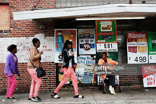 People walk through a poor neighborhood in Pensacola on December 4 2016 in Pensacola Florida Pensacola along with much of the Panhandle regions along...
