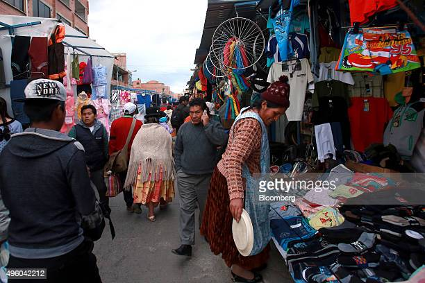 People walk through a street market in El Alto, Bolivia on Tuesday, Oct. 20, 2015. Bolivia which has experienced economic growth over the last...