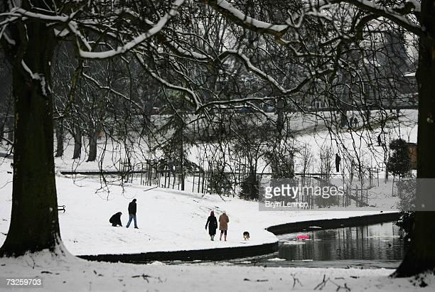 People walk through Abington Park as a heavy snowfall sweeps across the country on February 8 in Northampton United Kingdom Heavy snowfall across the...