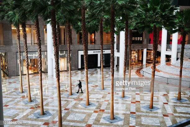 People walk through an empty Brookfield Place mall in lower Manhattan on March 29 2020 in New York City Across the country schools businesses and...