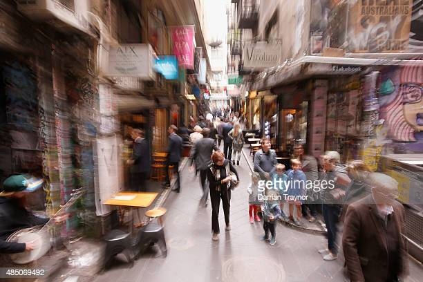 People walk through Centre Place on August 24 2015 in Melbourne Australia