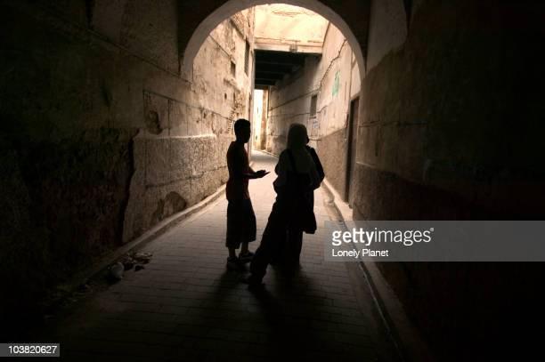 People walk through dark tunnel, Andalous.