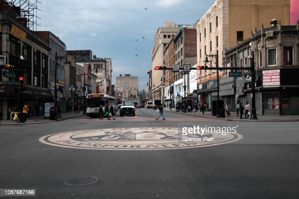 People walk through downtown Newark as the city experiences a rise in Covid-19 cases on November 25, 2020 in Newark, New Jersey. Newark residents...