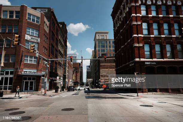 People walk through downtown on July 28, 2019 in Baltimore, Maryland. President Donald Trump has recently drawn criticism by calling the city of...