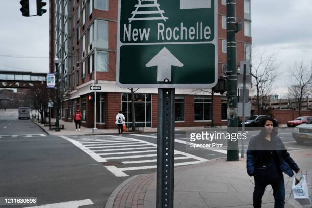People walk through downtown on March 10 2020 in New Rochelle New York New Rochelle a city just north of New York City has become the state's largest...