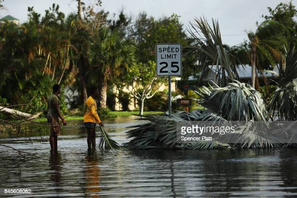 People walk through flooded streets the morning after Hurricane Irma swept through the area on September 11 2017 in Naples Florida Hurricane Irma...
