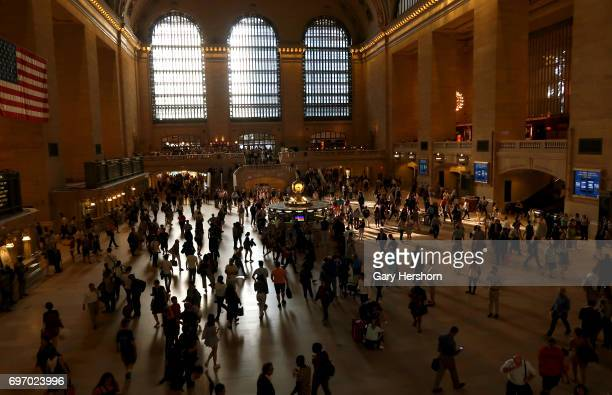 People walk through Grand Central Terminal in New York City on June 12 2017