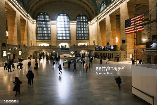 People walk through Grand Central Terminal on October 13, 2020 in New York City. New York City, which has increasingly built its economy around the...