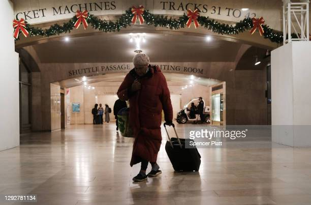 People walk through Grand Central Terminal two days before the Christmas holiday on December 23, 2020 in New York City. Grand Central Terminal, one...