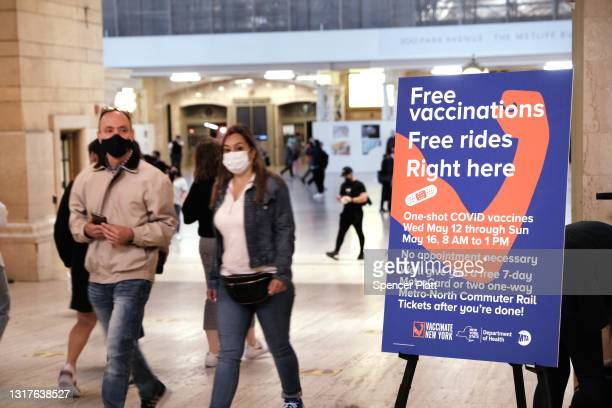 People walk through Grand Central Terminal where a pop-up site for COVID-19 vaccinations opened on May 12, 2021 in New York City. The pop-up site is...