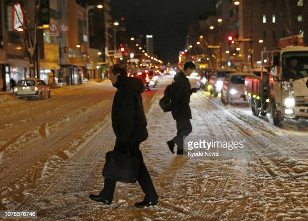 People walk through heavy snow in Aomori northeastern Japan on Dec 28 2018 ==Kyodo