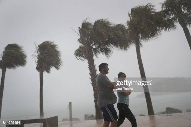 People walk through high winds and rain as Hurricane Irma approaches on September 9 2017 in Miami Beach Florida Florida is in the path of the...