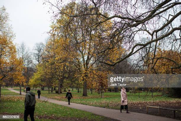 People walk through Kensington Gardens on November 24 2017 in London England The American actress Meghan Markle will live at Nottingham Cottage in...
