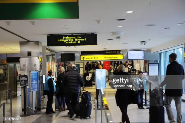People walk through LaGuardia Airport after the Federal Aviation Administration announced it is delaying flights into multiple airports due to...
