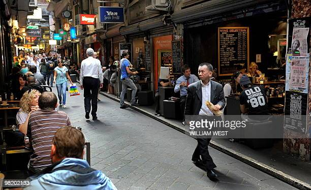 People walk through laneways in innercity Melbourne which is home to many vibrant bars cafes restaurants boutiques sushi bars and shops as well as...