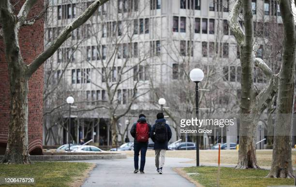 CAMBRIDGE MA MARCH 10 People walk through MIT's campus in Cambridge MA on March 10 2020 Some colleges have moved all classes online amid coronavirus...