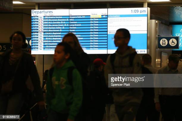 People walk through New York's Pennsylvania Station on February 16 2018 in New York City Amtrak gave a media tour on Friday to show the progress made...