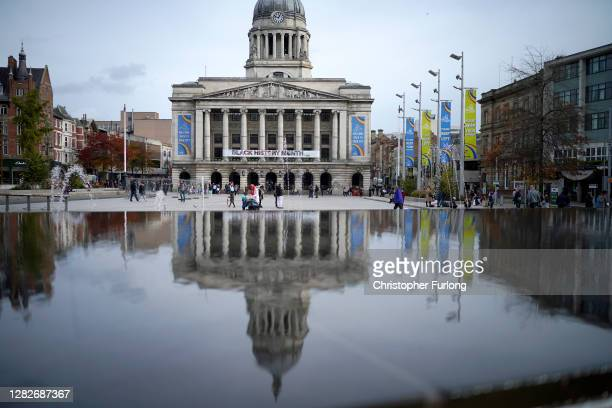 People walk through Nottingham City centre ahead of Tier Three restrictions on October 28, 2020 in Nottingham, England. The city of Nottingham is set...