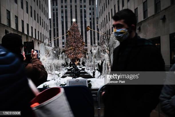 People walk through Rockefeller Center on the last Sunday before Christmas on December 20, 2020 in New York City. Rockefeller Center, where the...