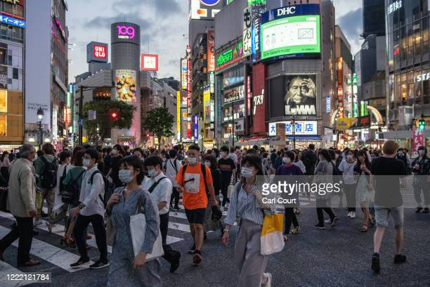 People walk through Shibuya on June 23, 2020 in Tokyo, Japan. Restrictions on businesses in Tokyo were fully lifted recently as the Covid-19...