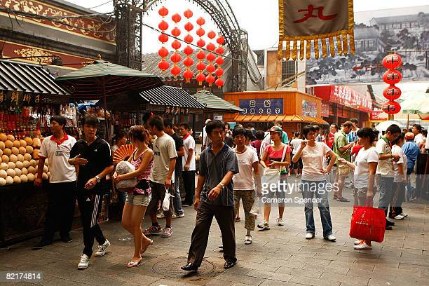 People walk through stalls at the Wangfujing markets ahead of the Beijing 2008 Olympic Games on August 4, 2008 in Beijing, China.