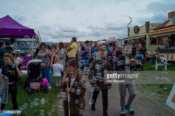 People walk through stands during the annual Appleby Horse Fair on June 07 2019 in ApplebyinWestmorland England The annual gathering for Gypsy Romany...