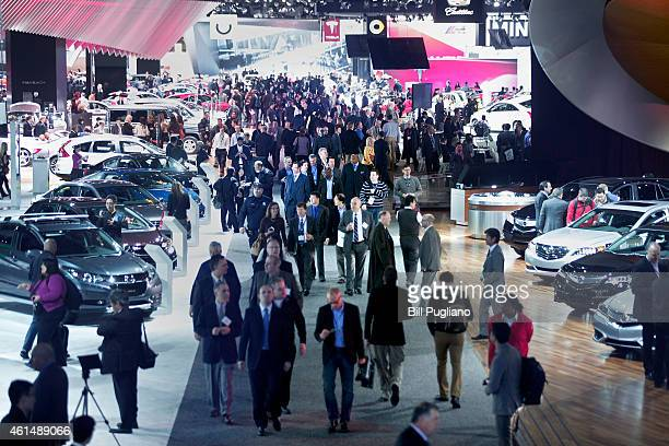 People walk through the 2015 North American International Auto Show floor on January 13, 2015 in Detroit, Michigan. More than 5000 journalists from...