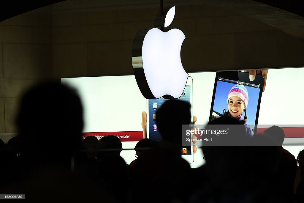 People walk through the Apple retail store in Grand Central Terminal on December 10, 2012 in New York City. Apple Inc. stock was down $4.56 per share, or 0.86 percent decline as investors and analysts worry that the U.S market is becoming saturated with apple products. Apple, the world's most valuable publicly traded company, has lost $167 billion in market value in less than three months.