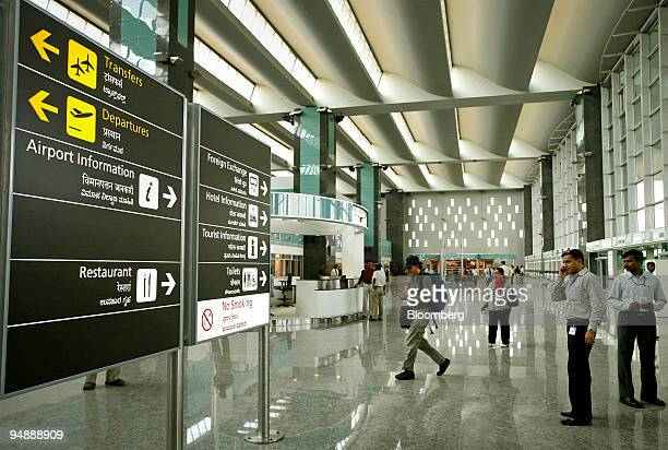 People walk through the arrival area at the Bangalore International Airport in Bangalore India on Wednesday May 21 2008 Bangalore International...