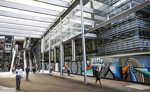 People walk through the Barangaroo area in the central business district of Sydney Australia on Monday Jan 23 2017 Australia is leading a push to...