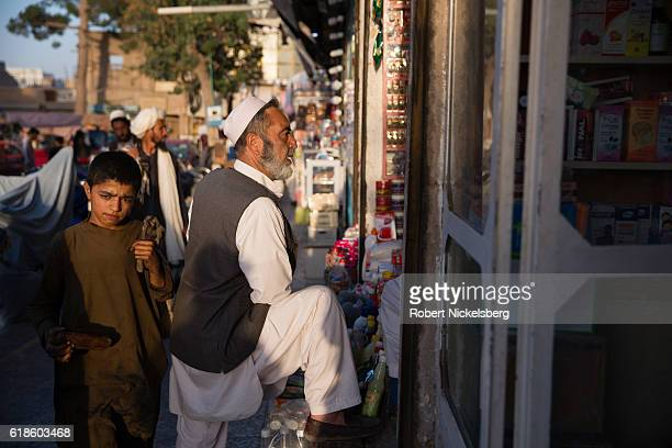 People walk through the bazaar September 10 2016 in Herat Afghanistan Herat is the third largest city in Afghanistan with a population of...