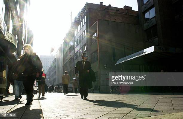 People walk through the center of the diamond district October 31 2002 in Antwerp Belgium The gem traders in Antwerp are under pressure to regulate...