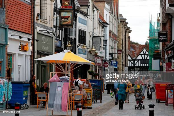People walk through the centre of Salisbury southern England on September 4 2020 near to the scene of the nerve agent attack on Russian exspy Sergei...