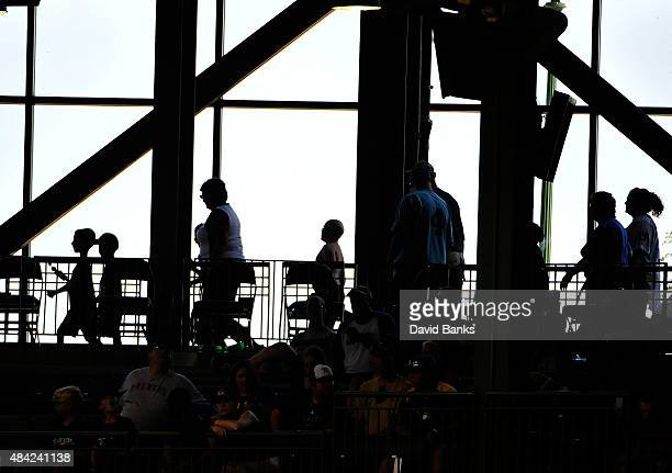 People walk through the concourse during the eighth inning of a game between the Milwaukee Brewers and the Philadelphia Phillies on August 16 2015 at...