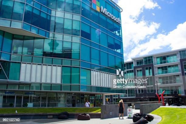 People walk through the corporate campus at the regional headquarters of Microsoft in Auckland New Zealand February 26 2018